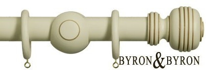 Wooden curtain poles by Byron and Byron
