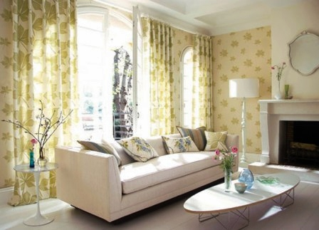 patterned green and cream wallpaper and curtains