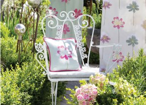 Floral cushions with matching wallpaper and curtain fabric.